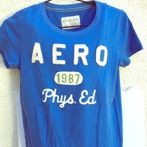 Aero 1987 Phys Ed Graphic Tee NWOT